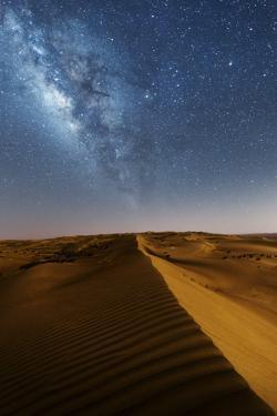 Oman, Wahiba Sands. the Sand Dunes at Night Lit by the Moon with the Milky Way by Matteo Colombo