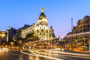 Spain, Madrid. Cityscape at Dusk with Famous Metropolis Building by Matteo Colombo