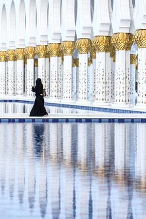 United Arab Emirates, Abu Dhabi. Arabic Woman Walking Inside Sheikh Zayed Grand Mosque by Matteo Colombo