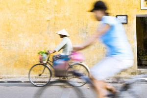 Vietnam, Hoi An. Local People on Bicycle in the Streets of the Town by Matteo Colombo