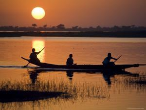 Young Boys Paddling on the Niger River in Segoukoro by Matthew Schoenfelder