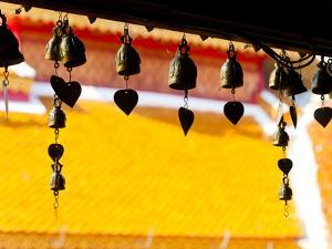 Close Up of Prayer Bells Silhouetted Against Colourful Roof at Wat Doi Suthep, Chiang Mai, Thailand by Matthew Williams-Ellis