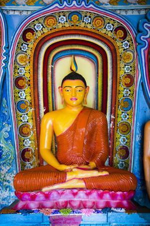 Colourful Buddha Statue at Isurumuniya Vihara by Matthew Williams-Ellis