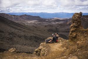Couple Resting on the Tongariro Alpine Crossing, Tongariro National Park by Matthew Williams-Ellis