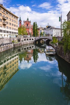 Ljubljana Triple Bridge and Franciscan Church of the Annunciation Reflected in Ljubljanica River