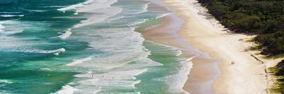Panoramic Photo of Surfers Heading Out to Surf on Tallow Beach at Cape Byron Bay, Australia