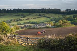 Tractor Ploughing Fields in Blockley, the Cotswolds, Gloucestershire, England by Matthew Williams-Ellis
