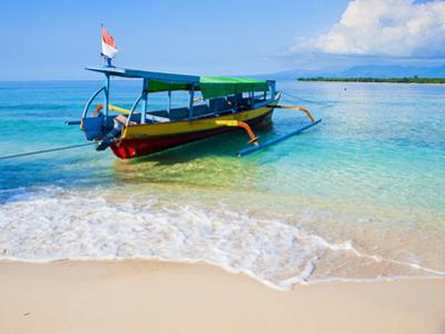 Traditional Indonesian Outrigger Fishing Boat on Island of Gili Meno in Gili Isles, Indonesia by Matthew Williams-Ellis
