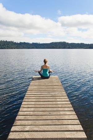 Woman Meditating on a Jetty, Lake Ianthe, West Coast, South Island, New Zealand, Pacific by Matthew Williams-Ellis
