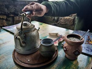 A Hand on a Teapot and Yerba Mate at Refugio Piltriquitron in the Andes of Patagonia, Argentina by Maureen Eversgerd