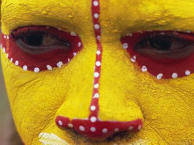 Close up of Facial Decoration in Yellow, Red and White Make-Up, Papua New Guinea, Pacific