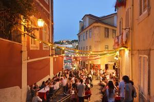 A Restaurant in the Calcada Do Duque, with a View to Sao Jorge Castle at Twilight. Lisbon, Portugal by Mauricio Abreu