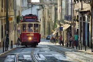 A tramway in Alfama district with the Motherchurch (Se Catedral) in the background. Lisbon, Portuga by Mauricio Abreu
