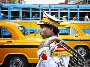 Member of a Music Band. Streets of Kolkata. India by Mauricio Abreu