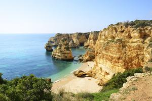 The coastal rock formations at Marinha beach (Praia da Marinha). Algarve, Portugal by Mauricio Abreu