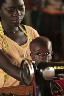 Working Mother And Child, Uganda by Mauro Fermariello