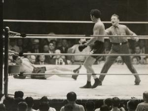 Max Schmeling on the Floor for a Count of Nine in His Match with Max Baer