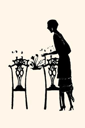 Homemaker Sets Table with a Bouquet of Flowers