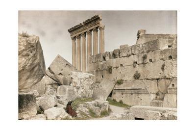 A Woman Sits Amongst the Massive Stones of Baalbek Ruins by Maynard Owen Williams