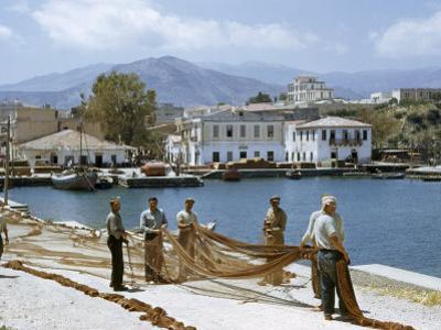 Fishermen Spread their Nets on Sun-Baked Wharves by Maynard Owen Williams