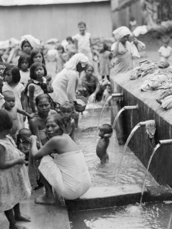 Moslem Women Attend a Ceremonial Bathing Spot by Maynard Owen Williams