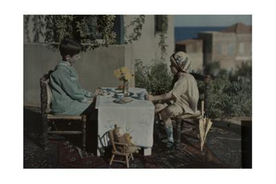 Two Children Have a Tea Party in Front of their House by Maynard Owen Williams