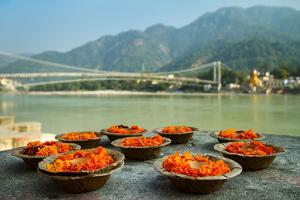 Puja Flowers Offering for the Ganges River in Rishikesh, India by mazzzur