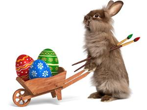 Funny Easter Bunny Rabbit With A Wheelbarrow And Some Easter Eggs by mdorottya