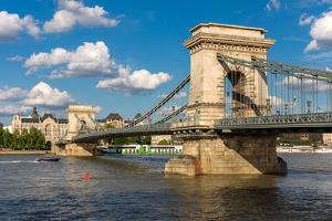 The Chain Bridge in Budapest under A Blue Cloudy Sky by mdorottya