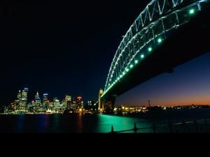 A View Across Sydney Harbour of the Brightly-Lit Harbour Bridge and the Citys Skyline by Medford Taylor