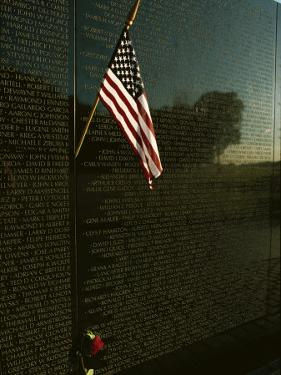 American Flag Left at the Vietnam Veterans Memorial by Medford Taylor