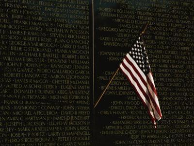 American Flag Left at the Vietnam Veterans Memorial by Medford Taylor