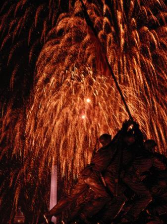 Fourth of July Fireworks Illuminate the Sky Behind the Iwo Jima Monument by Medford Taylor