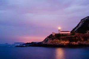 Cudillero Lighthouse Lights up Night by Megan Ahrens