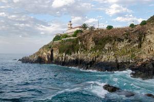 Lighthouse on a Rocky Coast by Megan Ahrens