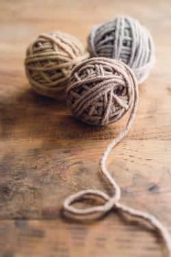 Balls of Wool on Wooden Background by Melica73
