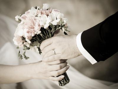 Groom Handing Wedding Bouquet to Bride