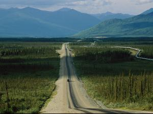 A Lone Truck Moves Down the Dalton Highway by Melissa Farlow