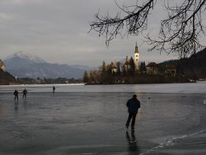 Hockey Players Brave the Cold and the Thin Ice for an Afternoon Game, Bled, Slovenia by Melissa Farlow