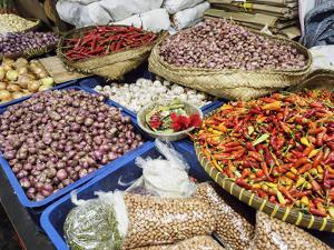 Colourful produce of peppers, garlic, onions, peanuts and shallots, at a market in Denpasar, Bali, by Melissa Kuhnell