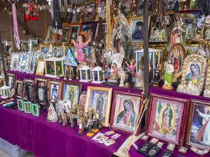 Stall selling holy images, Fiesta of the Virgin of Guadalupe, patron of Mexico, Oaxaca, Mexico, Nor by Melissa Kuhnell