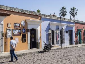 Street scene of colorful buildings, Oaxaca, Mexico, North America by Melissa Kuhnell