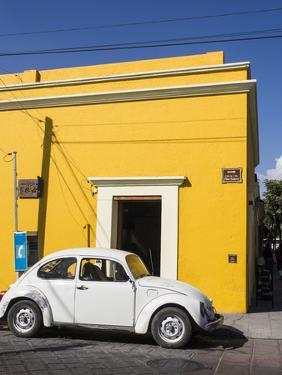 Yellow building and white VW bug, Oaxaca, Mexico, North America by Melissa Kuhnell