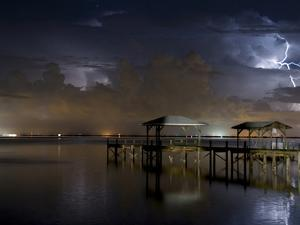 Lightning Off a Dock in Titusville, Florida Looking Towards Cape Canaveral by Melissa Southern