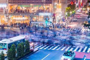 People and Traffic Crossing the Famous Shibuya Intersection by Melpomene