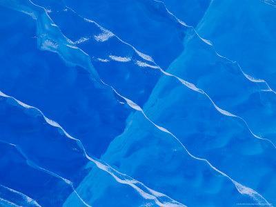 https://imgc.allpostersimages.com/img/posters/melt-ridges-on-deep-blue-iceberg-antarctic-peninsula_u-L-P58BC40.jpg?p=0