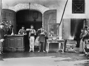 Men Eating Long Spaghetti at a Street Food Shop in Naples, Italy, Ca. 1900