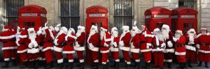 Men from the London Santa School, Dressed in Christmas Outfits, Pose by Telephone Boxes in London