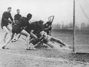 Men Playing Lacrosse