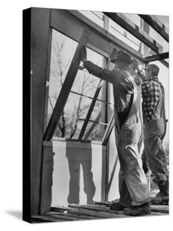 Men Putting Windows In